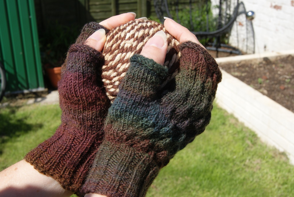 http://www.ravelry.com/patterns/library/strobilus-mitts