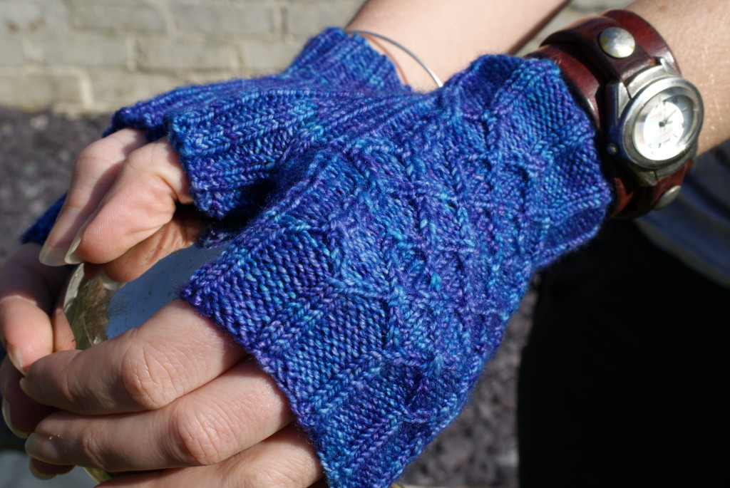http://www.ravelry.com/projects/fak/diamond-wristers-3