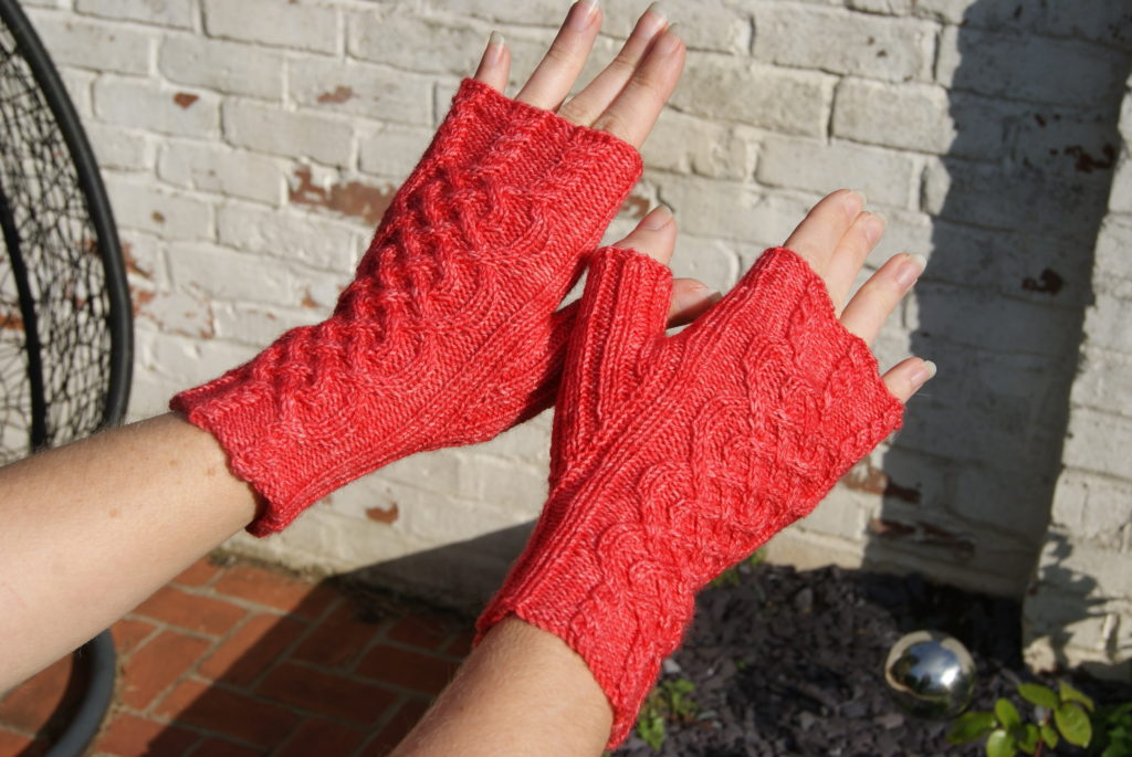 http://www.ravelry.com/projects/fak/penda-fingerless-mittens