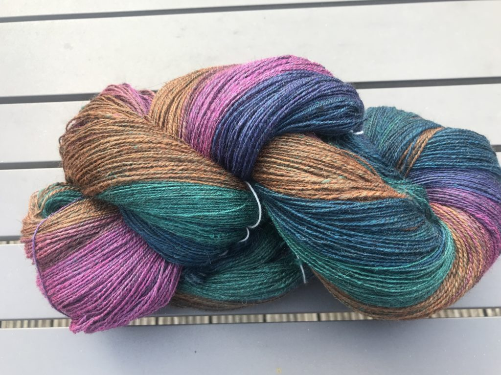 Purple, green, blue and brown yarn